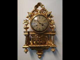 Seinäpendyyli kello
